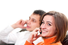 Happy couple talking on cell phones Stock Images