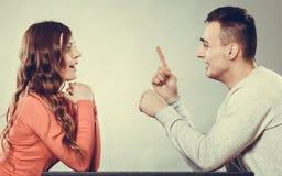 Happy couple talking on date. Conversation. Happy couple talking and laughing on date. Smiling girl and guy having conversation. Amusing men making women laugh royalty free stock photos