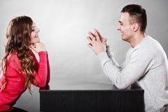 Happy couple talking on date. Conversation. Stock Photos