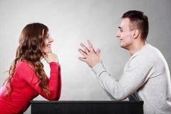 Happy couple talking on date. Conversation. Happy couple talking and laughing on date. Smiling girl and guy having conversation. Amusing men making women laugh royalty free stock image