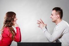 Happy couple talking on date. Conversation. Happy couple talking and laughing on date. Smiling girl and guy having conversation. Amusing men making women laugh stock photos