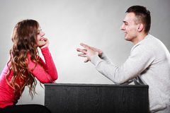 Happy couple talking on date. Conversation. Happy couple talking and laughing on date. Smiling girl and guy having conversation. Amusing men making women laugh royalty free stock images