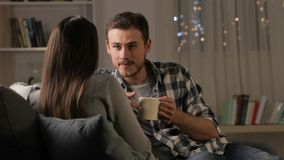 Couple talking and drinking coffee at home stock video footage