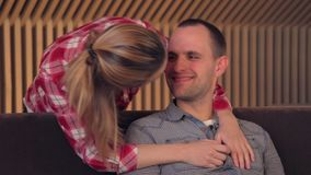Happy couple talking in the living room stock footage