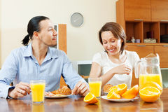 Happy couple talking over breakfast Stock Photography
