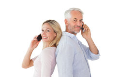 Happy couple talking on their smartphones Royalty Free Stock Image