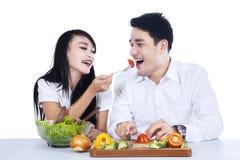 Happy couple tasting salad Royalty Free Stock Photo