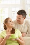 Happy couple with tea cup Royalty Free Stock Photo