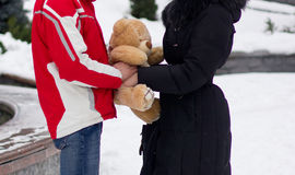 Happy couple with teddy bear Stock Photography