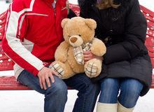 Happy couple with teddy bear Stock Photos
