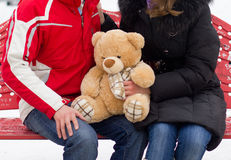 Happy couple with teddy bear Stock Images