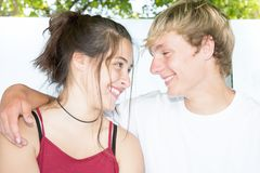 Happy couple teen laughing. Portrait of a happy couple teen laughing each other royalty free stock images