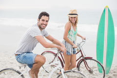 Happy couple with their bicycle on the beach Royalty Free Stock Photo