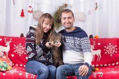 Christmas Couple with Cat Stock Image