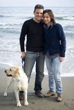 Happy couple with their dog Stock Photography