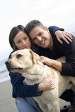 Happy couple with their dog Royalty Free Stock Image