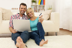 Happy couple in their home Royalty Free Stock Photos