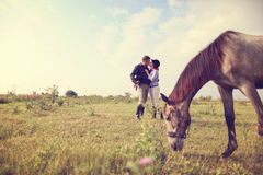 Happy couple with their horse Royalty Free Stock Photo