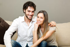 Happy couple in their house Stock Images