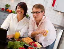 Happy couple in their kitchen Royalty Free Stock Images