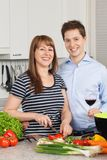 Happy couple in their kitchen Stock Photography
