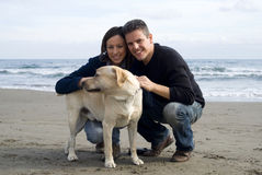 Happy couple with their labrador Royalty Free Stock Images