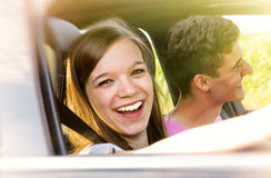 Happy couple in their new car Stock Photography