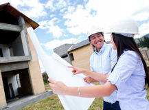 Happy couple with their new house Royalty Free Stock Image