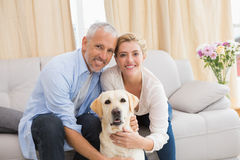 Happy couple with their pet dog Royalty Free Stock Images
