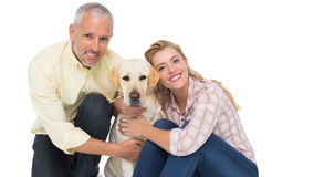 Happy couple with their pet dog Stock Images