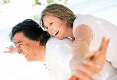 Happy couple in their vacations Stock Photography