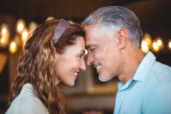 Happy couple with theirs heads close together Stock Photo
