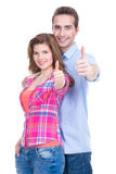 Happy couple with thumbs up sign. Portrait of happy couple with thumbs up sign isolated on white background Stock Photo