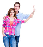 Happy couple with thumbs up sign. Royalty Free Stock Photography