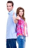 Happy couple with thumbs up sign. Royalty Free Stock Image
