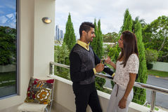 Happy couple. Toasting on modern balcony Royalty Free Stock Image