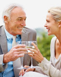 Happy couple toasting wine glasses outdoors Royalty Free Stock Photography