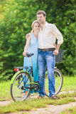 Happy Couple Together with Bicycle. Positive Expression Stock Photo