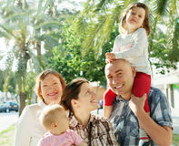 Happy couple together with children and grandmother Stock Photos