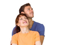 Happy couple together looking upwards Royalty Free Stock Images