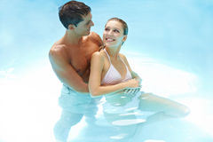 Happy couple together in pool Royalty Free Stock Photo