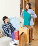 Happy couple together with shopping bags. In home interior Royalty Free Stock Photography