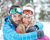 Happy couple together on ski trip stock images