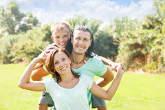 Happy couple together with teenager Stock Photos