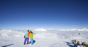 Happy couple at the top of the mountain royalty free stock photos