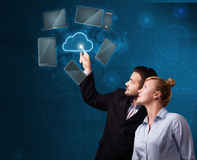 Happy couple touching cloud service Stock Photo