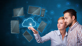 Happy couple touching cloud service Royalty Free Stock Photos