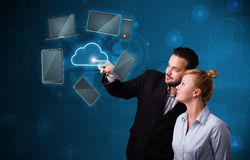 Happy couple touching cloud service Royalty Free Stock Images