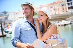 Happy couple of tourists on holidays Stock Photography