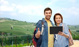 Happy couple of tourists with tablet computer royalty free stock photos